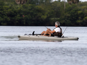 A TECO Energy Supply Services team member fishes from a kayak in the group's second annual tournament, held to raise funds for the Mary & Martha House.