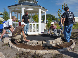 Tampa Electric team members build a terrace at the Florida State Fairgrounds.
