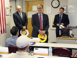 In 2013, then-U.S. Secretary of Labor Thomas Perez, flanked here by Bill Whale to the left and Gordon Gillette, right, visits apprentice linemen in training at the Skills Training Center. (Our training regimen is the real deal, in other words.)