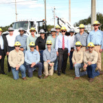 Secretary Perez poses with Tampa Electric team members at the Skills Training Center.