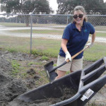 Nicki, a Tampa Electric team member, gets down to business at the Florida Learning Garden.