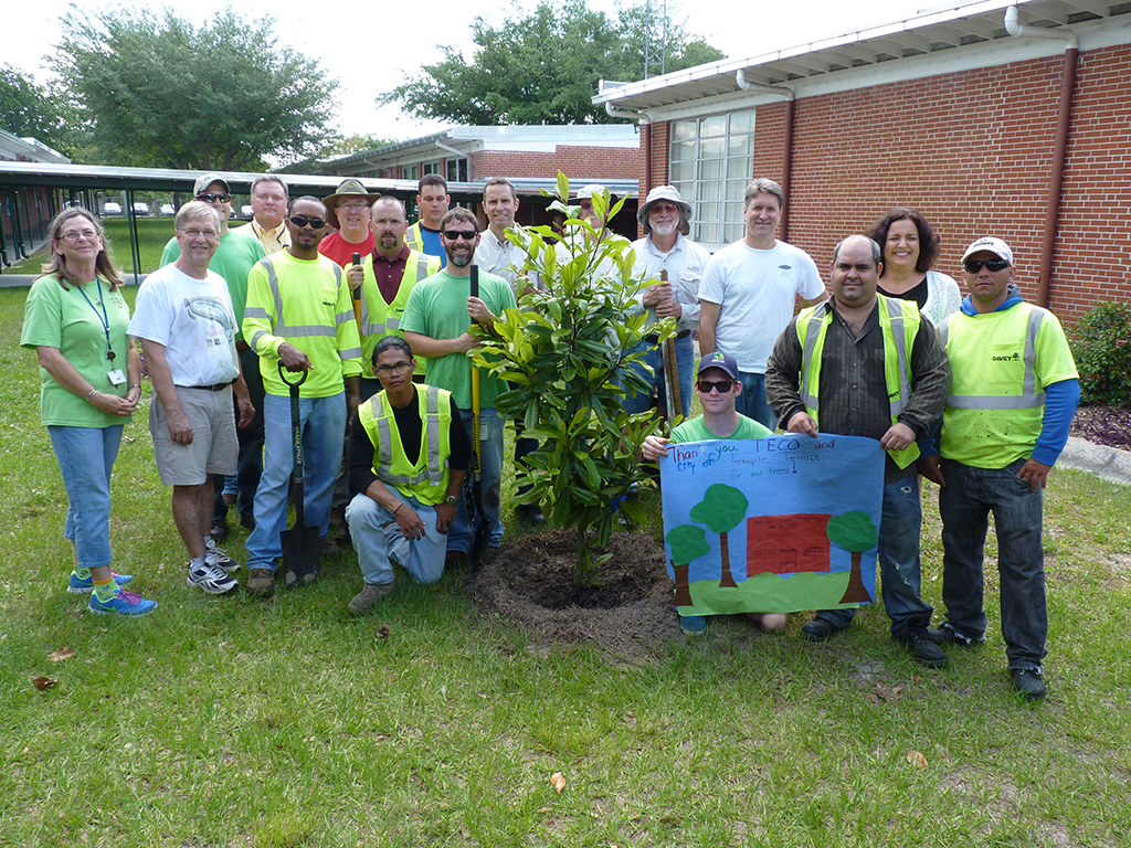 Team members mark arbor day by planting trees in community for The terrace group