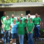 Volunteers with TECO's South Hillsborough Operations team put down the paint brushes to pause for a photo.