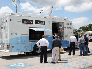 TECO leaders at the unveiling of the command response vehicle. Note the screen on the side of the vehicle that will enable crisis responders to receive the latest information about the restoration situation.