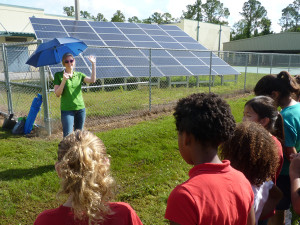 Tampa Electric's Shelly Whitworth tells students at Lawton Chiles Elementary all about their school's Tampa Electric-installed photovoltaic array.