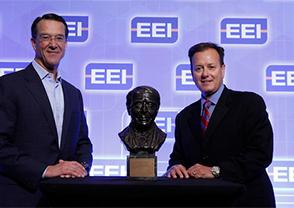 TECO Energy President and CEO John Ramil, right, accepts the Edison Award.
