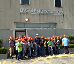 Tampa Electric's Tim Conway, in the white hat, welcomes the students to Big Bend Power Station.