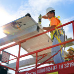 The first solar panel goes into place atop the south economy parking garage at Tampa International Airport.