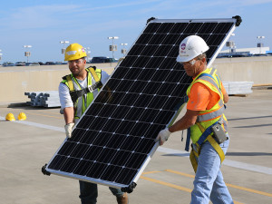 Solar panel installation at the site of Tampa Electric's 2-megawatt array at Tampa International Airport.