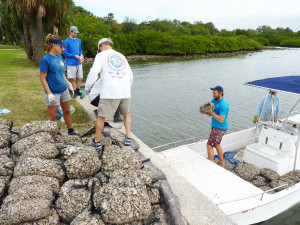 The shells get loaded onto one of two boats.