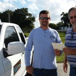 Kazmierski, right, and Walker  on their way to a customer's home to share the happy news from Shine the Light.