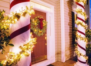 Christmas Lights Decorating Columns in Front of House