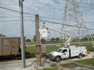 Although a lot of work by TECO's Support Services team members happens in office environments, a lot happens in the field. Here, Telecom Electrician Apprentice David Engnes works to replace old copper cable with more efficient fiber optic cable.