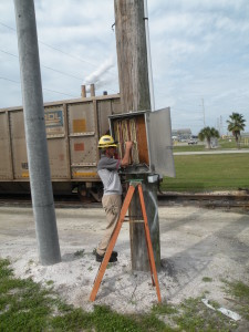 Electrician-I Ken Yancey checks for signals at a copper cable junction near Big Bend's DESAL substation.