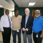 From left, at Trinity Cafe: Commissioner Thomas Scott; Robert Connelly, meter mechanic with Tampa Electric's Meter Services team; Mike Crouch, chairmen of the Elders at the 1st Church of God; and Marion Fleming, material specialist with Meter Services with Tampa Electric.