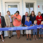 Kathy Guindon, director of FWC's Suncoast Youth Conservation Center, cuts the ribbon on the new building.