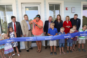 Kathy Guindon, director of FWC's Suncoast Youth Conservation Center, cuts the ribbon on the SYCC in 2016.