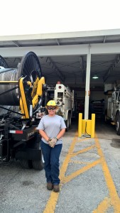 At Tampa Electric's Eastern Service Area, around some of the equipment she handles, Teena Dampier is on the job.