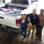 Brandi Scott, Will Carrera and Gerri Drummond with a truck loaded with donated school supplies for Metropolitan Ministries.