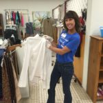 Stephanie Sarro helps organize items for the clothing store at Metropolitan Ministries' Tampa Heights campus.
