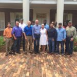 Governor Rick Scott and his wife at the Florida governor's mansion with TECO team members.