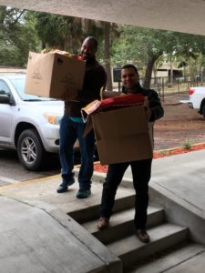 Chris Stoney, left, and Will Carrera, both with Credit and Collections, transport holiday stockings.