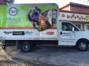A Meals on Wheels delivery truck, co-sponsored by TECO (note that you, as a volunteer, would drive your own car to deliver meals).
