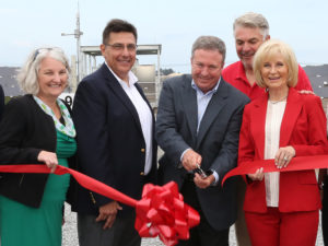 At the solar array ribbon-cutting, from left: Hillsborough County Commissioner Pat Kemp; Tom Hernandez and Gordon Gillette with TECO; in back is Paul Anderson, Port Tampa Bay President and CEO; and Hillsborough County Commissioner Sandra Murman.