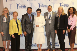 Members of the Centre for Women Board with the Waves of Change honorees, from left, Ashley Nessler, Former Mayor Sandy Freedman,Board Vice President Sul Hemani, Sheila Johnson, Board President Chris Jimenez, Treasurer Kim Caruso of TECO Energy, and Nancy Vaughn.
