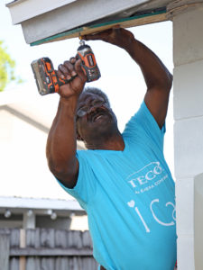 Tampa Electric Lineman and Paint Your Heart Out team leader Curley McKenzie gets the job done with more than a brush.
