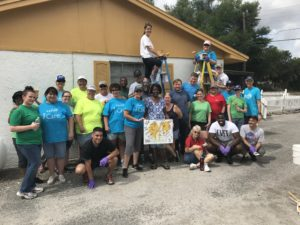 At another Paint Your Heart Out home site with TECO volunteers.