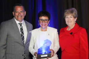 Board President Chris Jimenez with Sheila Johnson and Ann W. Madsen, Executive Director of the Helen Gordon Davis Centre for Women.