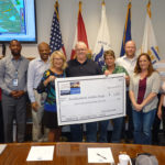 The check presentation to Southeastern Guide Dogs by TECO team members.