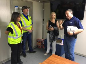 At our staging base at the Florida State Fairgrounds, Irma Lawrence and Alan Denham, left, join Hillsborough County Commissioner Sandra Murman for an update from Gordon Gillette.