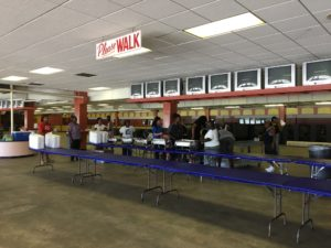 Employees of Lupton's Catering work to create a cafeteria at the Tampa Greyhound Track to feed more than 1,000 visiting crews from other utilities.